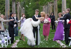 throwing-rose-petals-recessional-groom-carries-bride